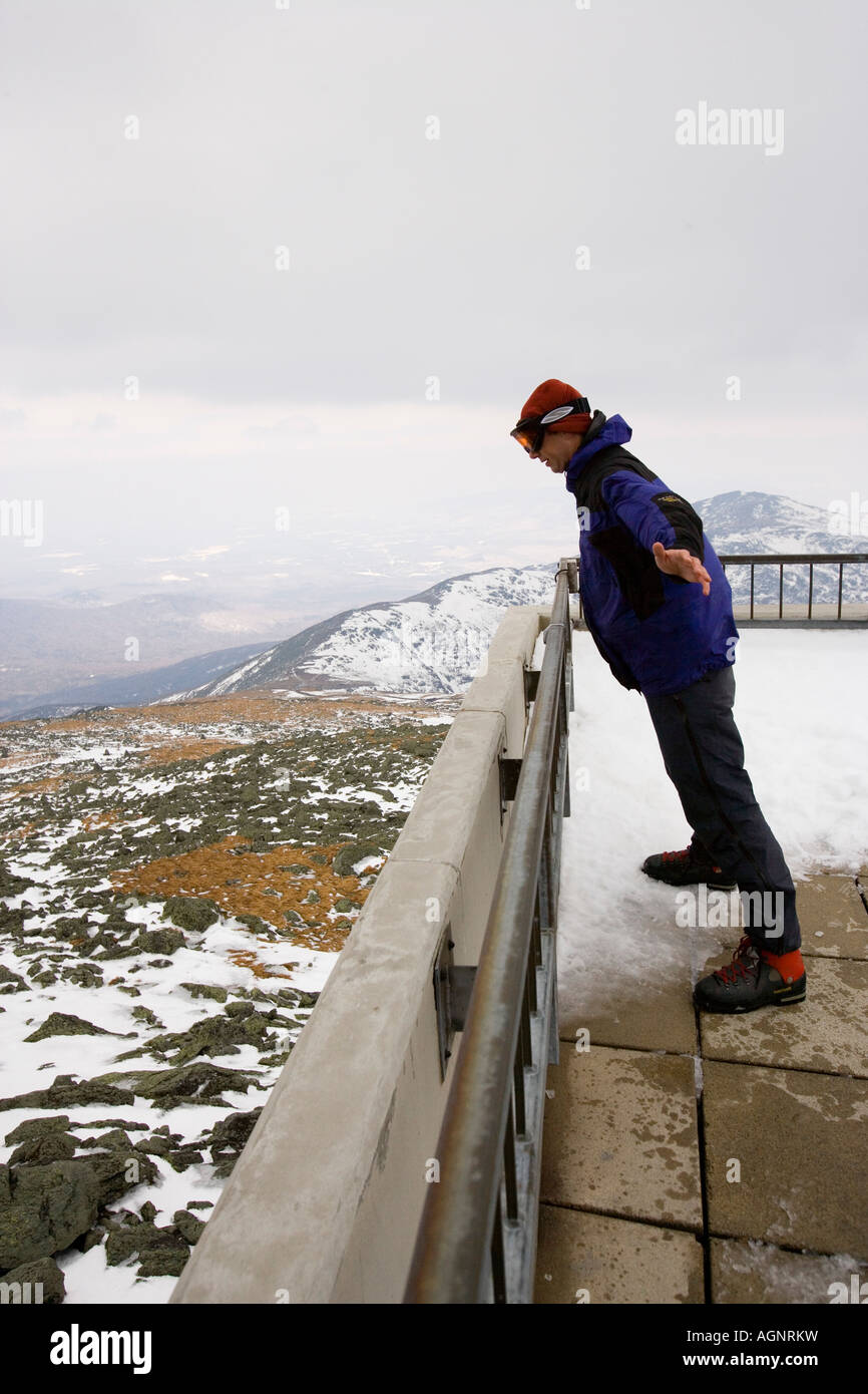 Matt Heid leaning into 50 mph winds on Mount Washington New Hampshire Observation deck March Stock Photo