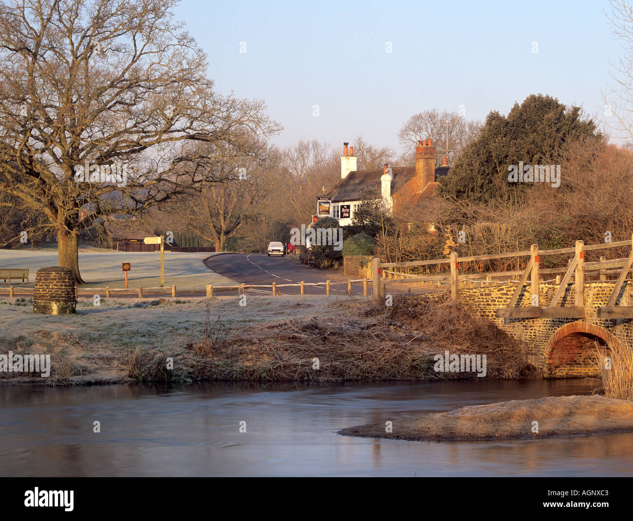 RIVER WEY flowing through the village in winter  Tilford Surrey England UK Europe - Stock Image
