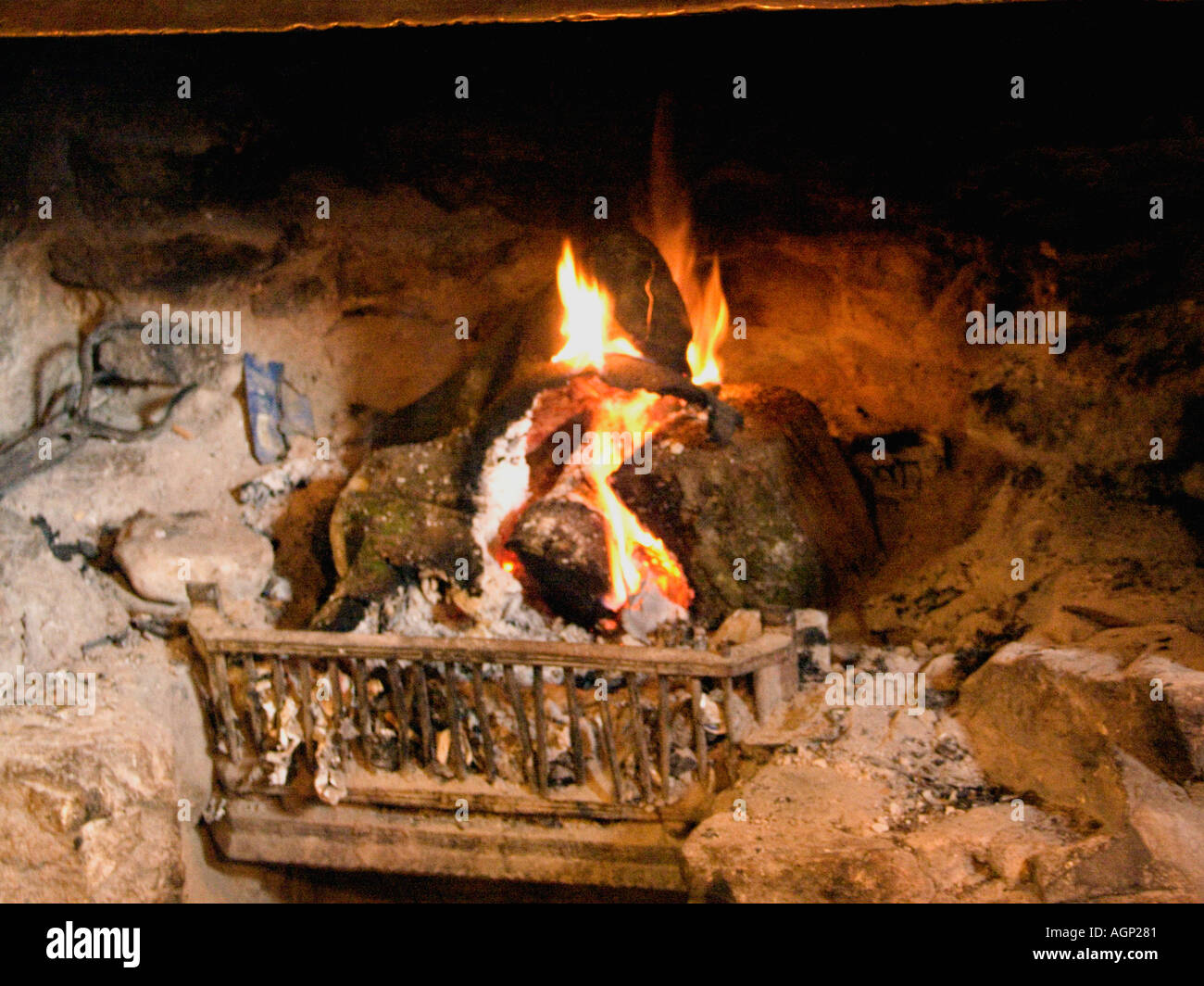 This Fire Burns All Year Long at the Warren House Inn, Dartmoor National Park, Devon, England, UK, - Stock Image