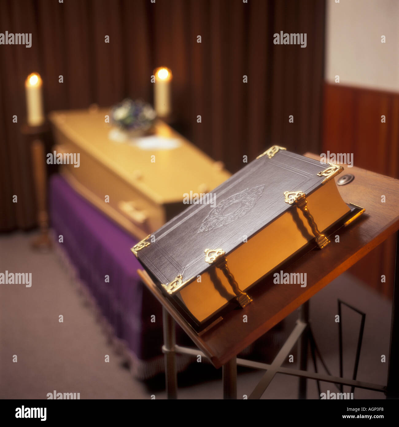 coffin with candles and a bible - Stock Image