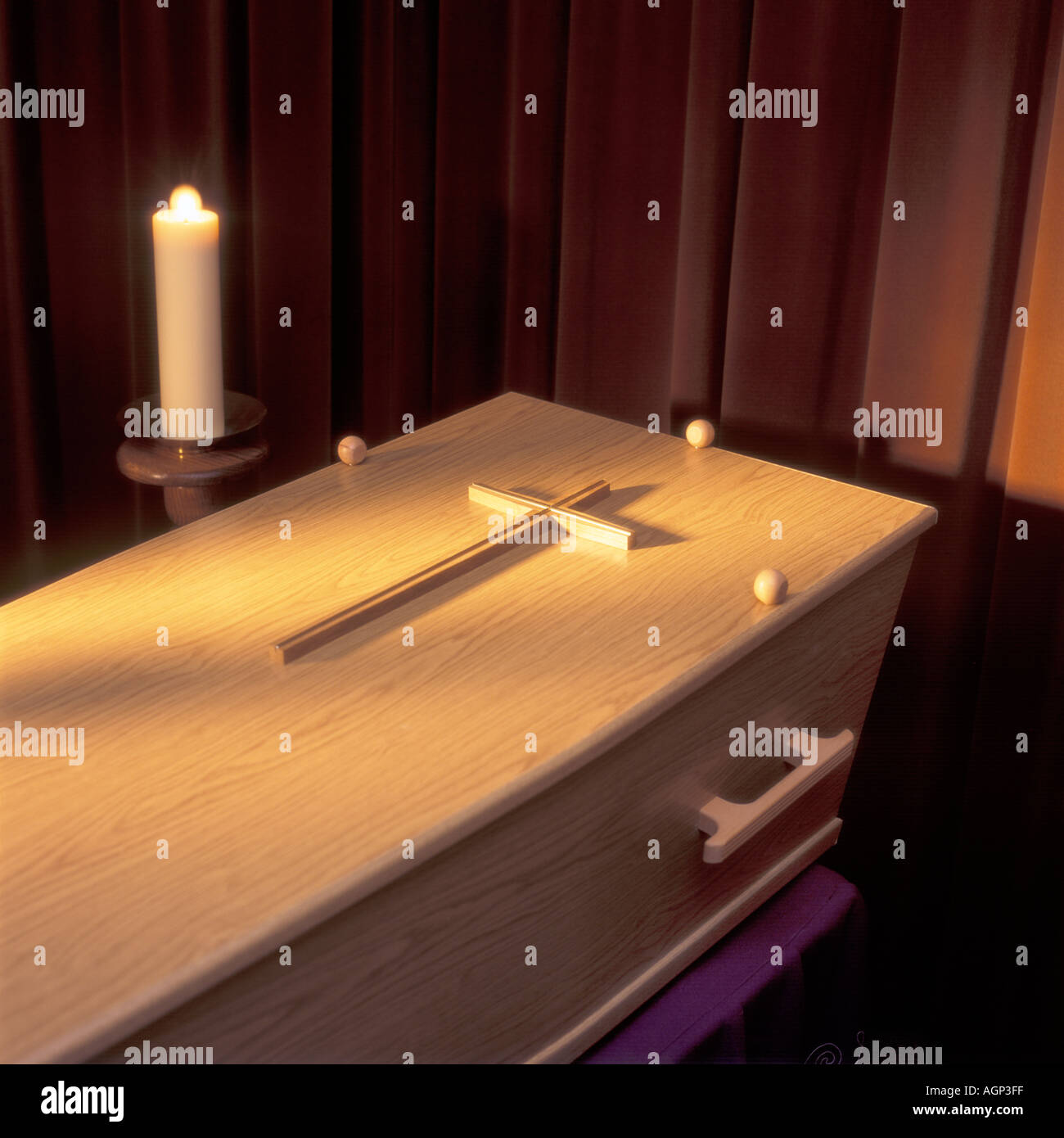 coffin with cross and candle - Stock Image