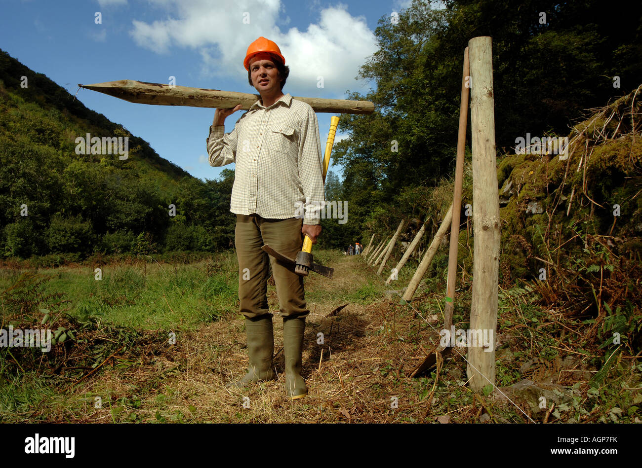 Image result for man with fence posts