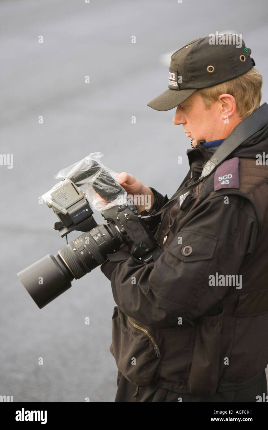 A police photographer photographs protestors at the camp - Stock Image