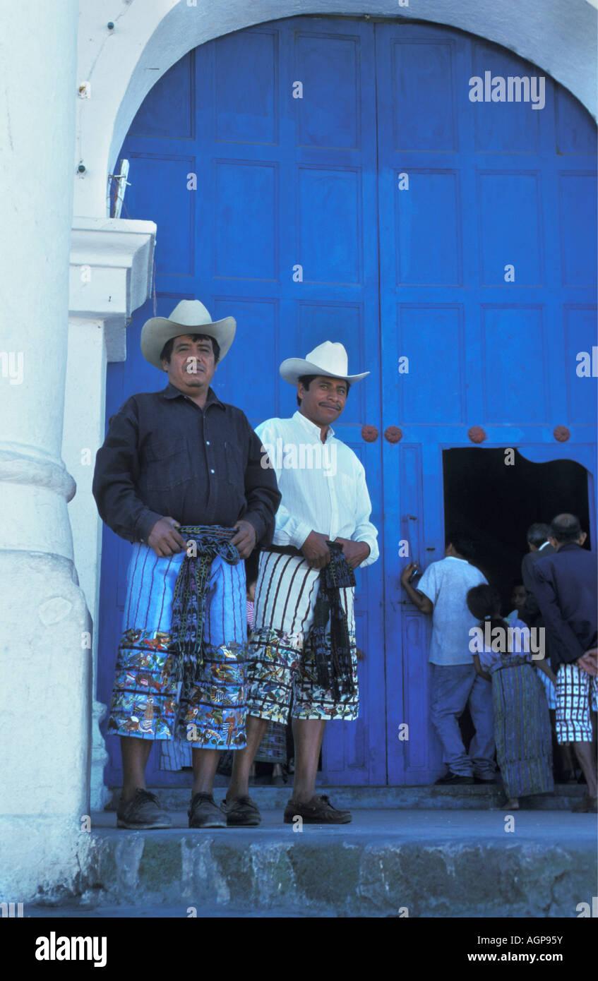 Guatemala Santiago de Atitlan Mid adult men standing outside church - Stock Image