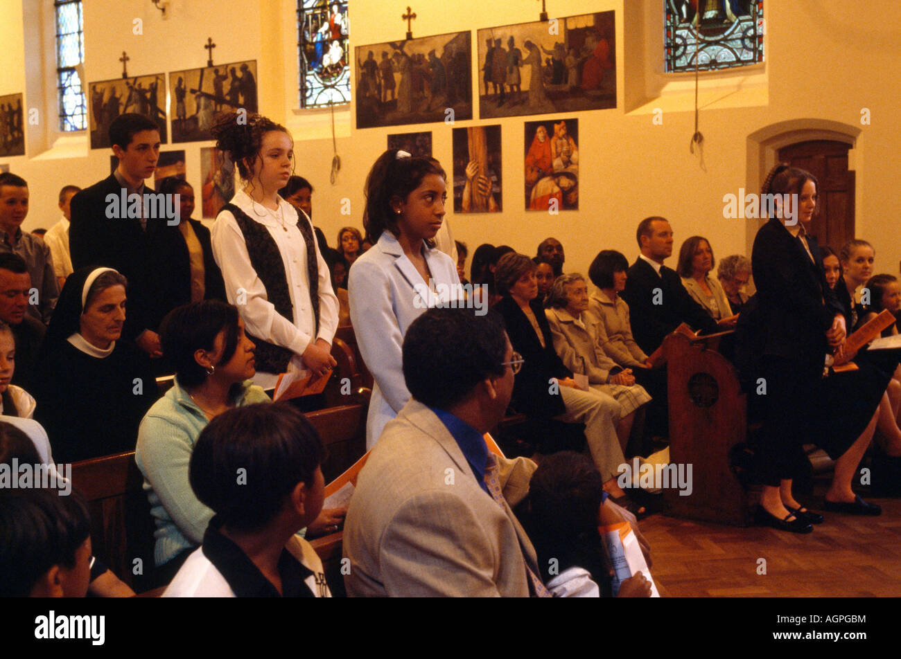 Confirmation Candidates Standing Renouncing Sins St Josephs Church England - Stock Image