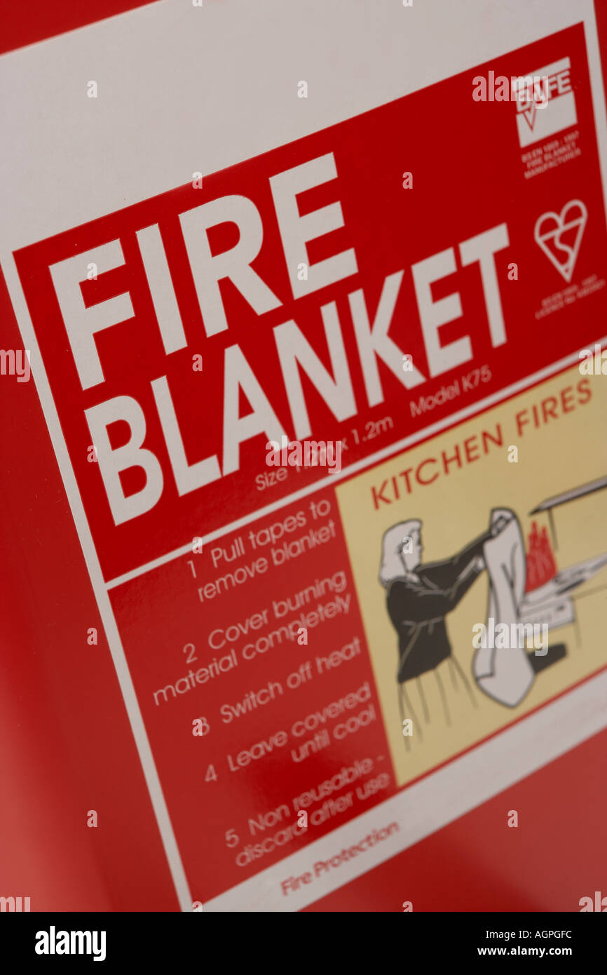 FIRE SAFETY BLANKET FOR USE IN KITCHEN FIRES - Stock Image