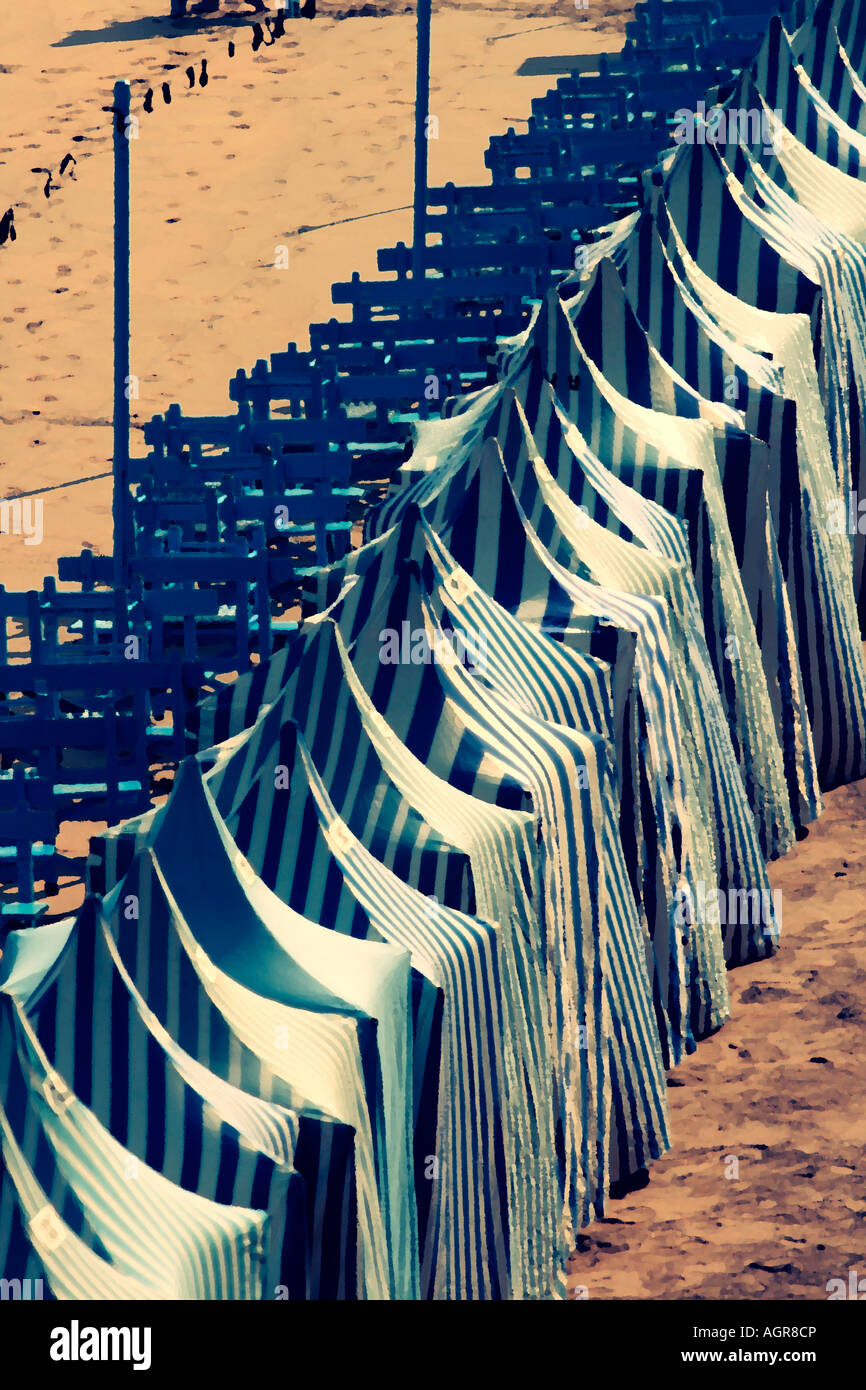 Stylised image of beach tents at Zarautz - Stock Image