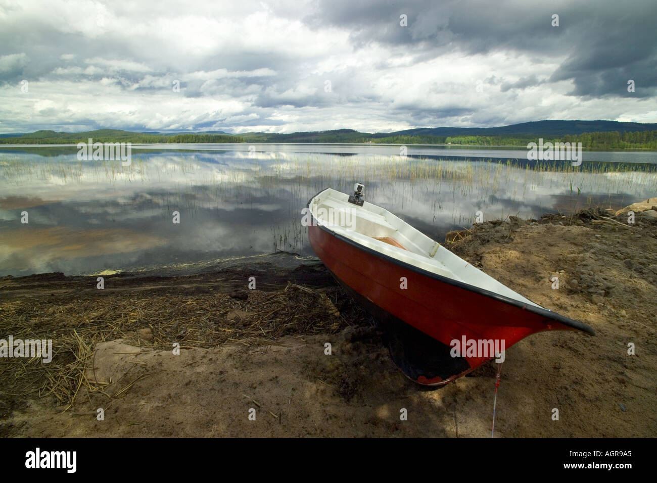 Boats on Beach of Lake Flaten near Torsby in Varmland County Sweden - Stock Image