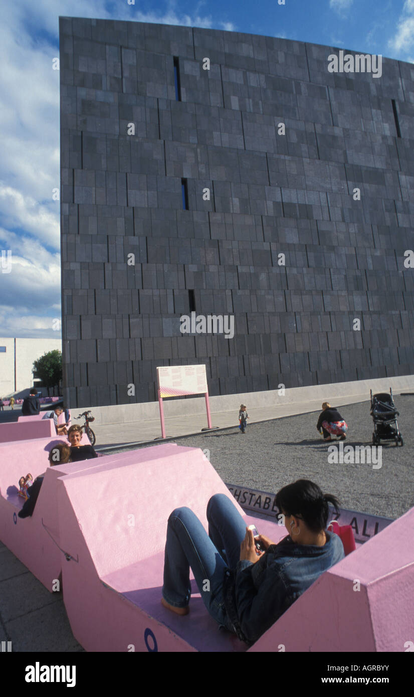 People relax in front of Museum Moderner Kunst Stiftung Ludwig MUMOK at the Museumsquartier in Vienna Austria - Stock Image