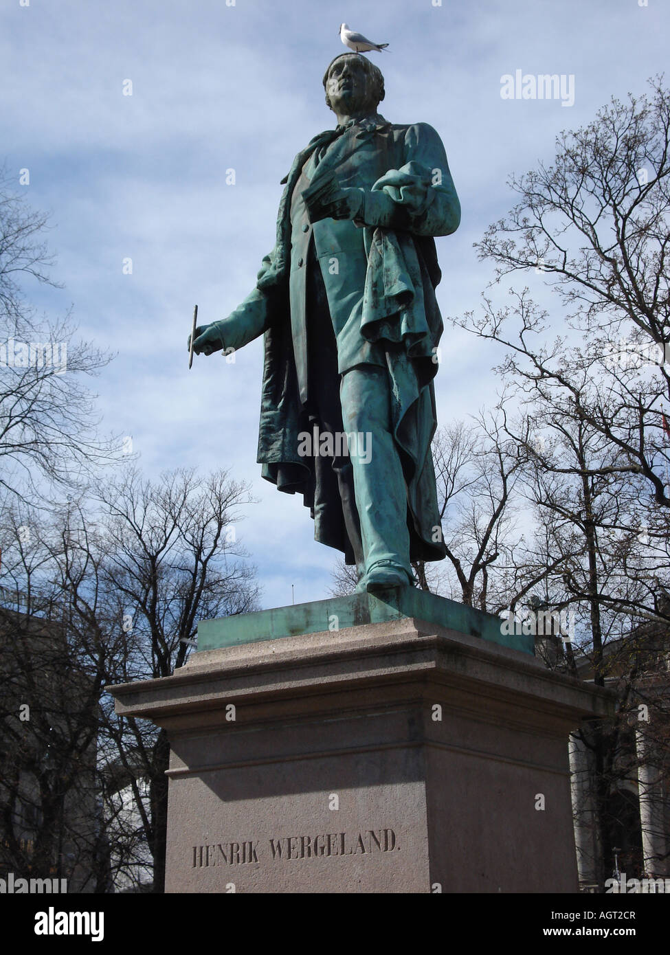 Statue of Henrik Wergeland with pigeon on his head, Oslo, Norway - Stock Image