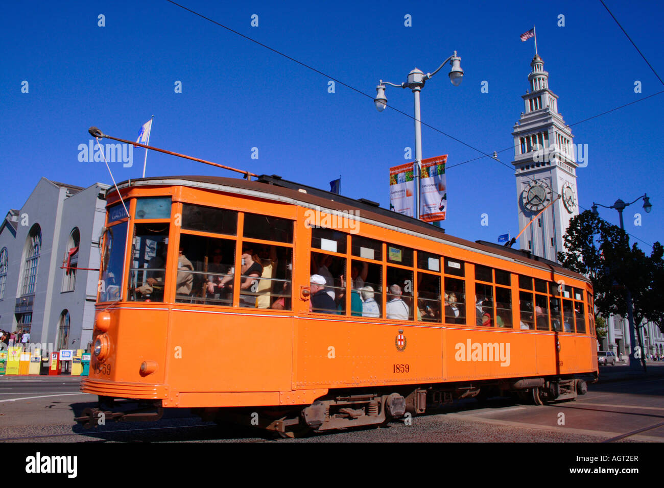 San Francisco streetcar with the Ferry Building clock tower in the background Stock Photo