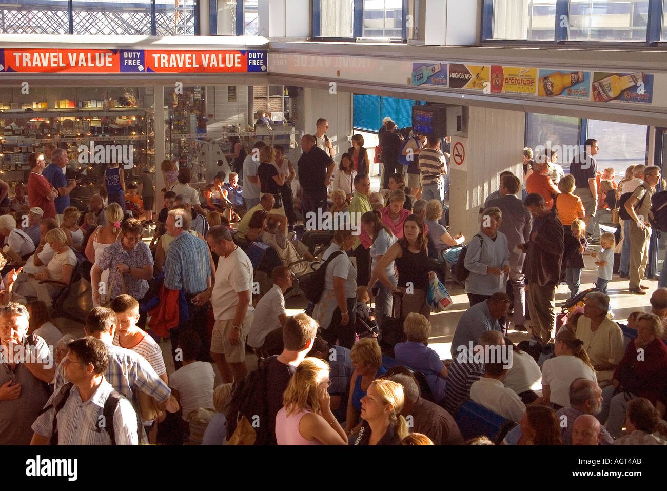 dh Kos Airport KOS AIRPORT GREECE KOS Tourist in departure lounge crowds due to air traffic controller strike delays - Stock Image