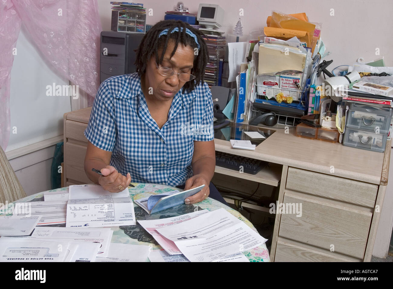 Woman Worries Over Paying Her Bills - Stock Image