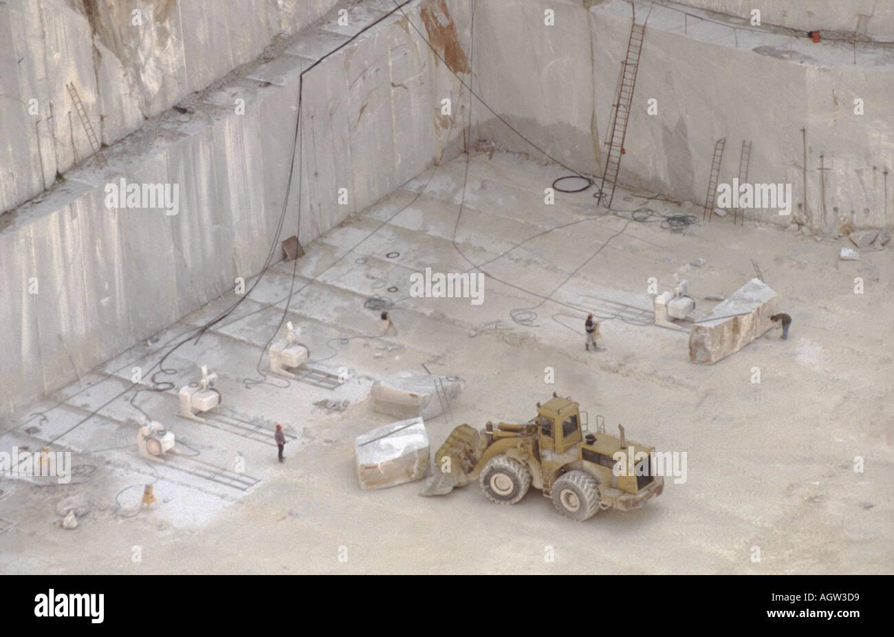 Excavator in Carrara Marble Quarry Tuscany Italy Stock Photo