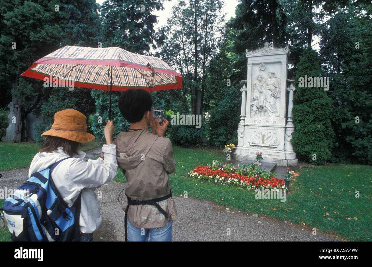 Tourists at the grave of Franz Schubert at the Zentralfriedhof cemetery in Vienna Austria - Stock Image