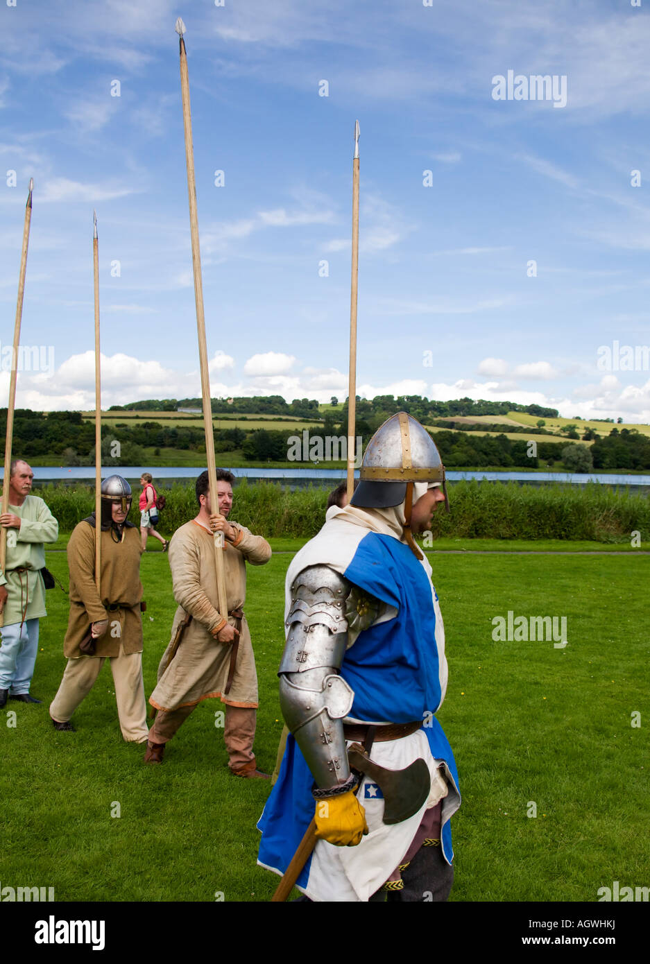 Medieval pikemen marching pikes held aloft - Stock Image