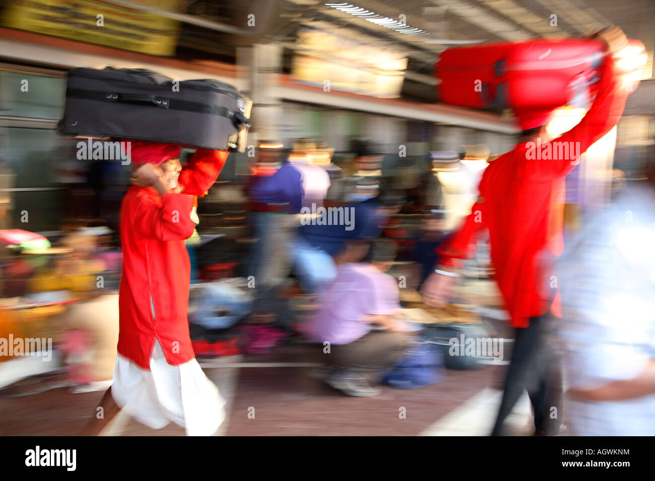 India Haridvar  Hardivar railway station platform porters baggage luggage travellers indians waiting 2007 - Stock Image