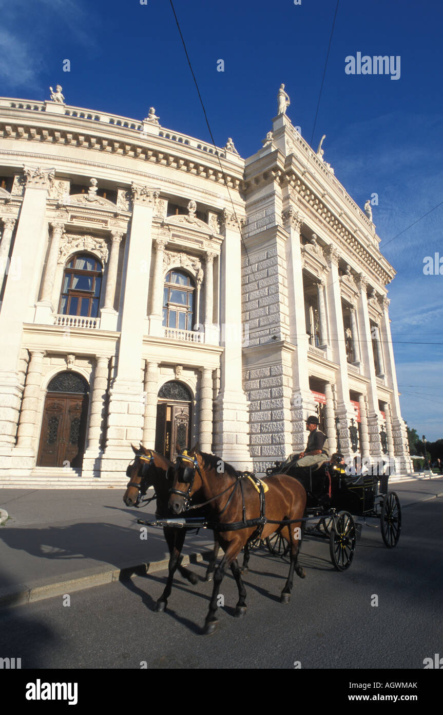 Hackney carriage in front of Burgtheater theatre building in Vienna Austria - Stock Image