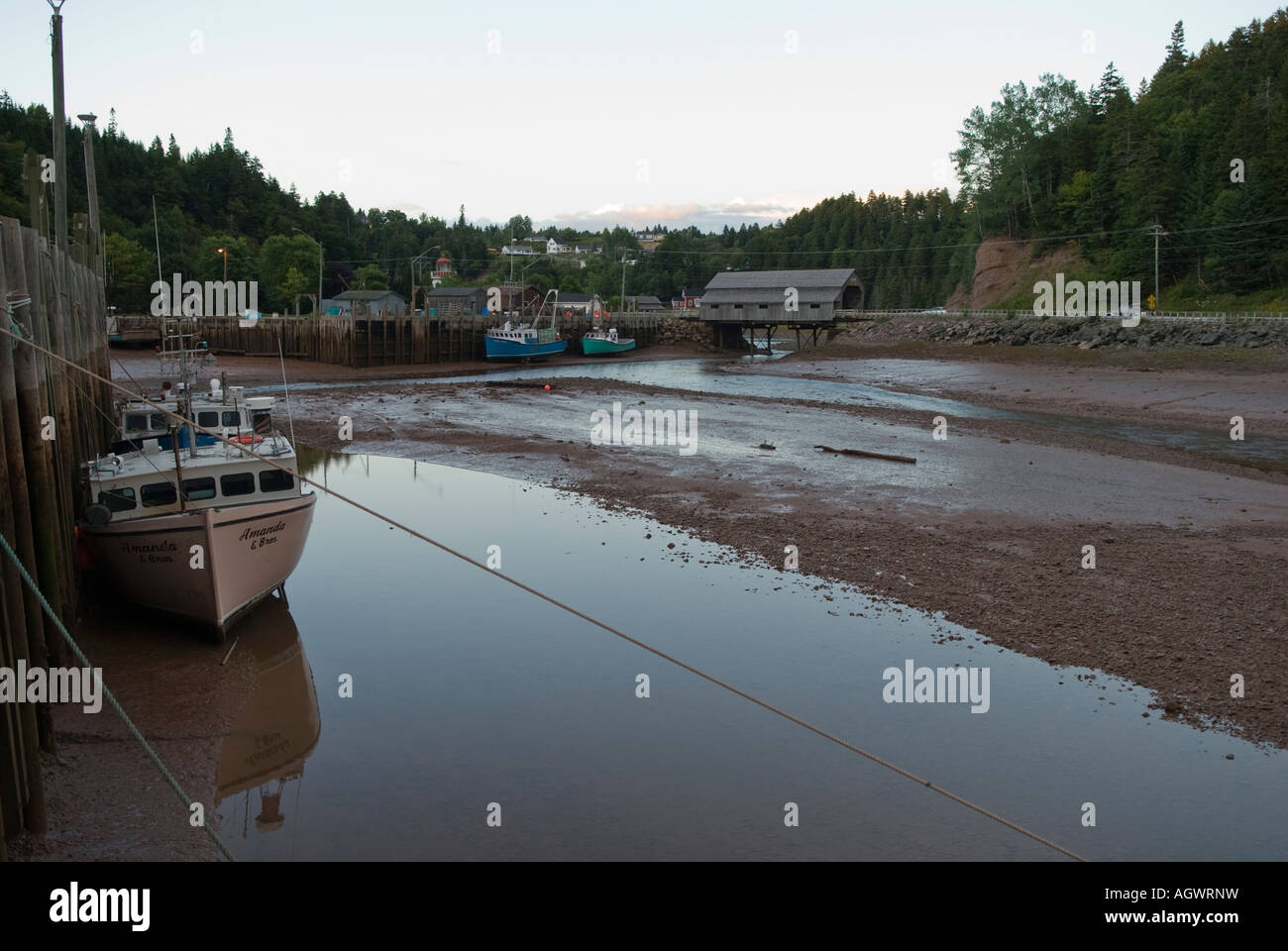 Fishing boats in St Martins New Brunswick sitting in the mud