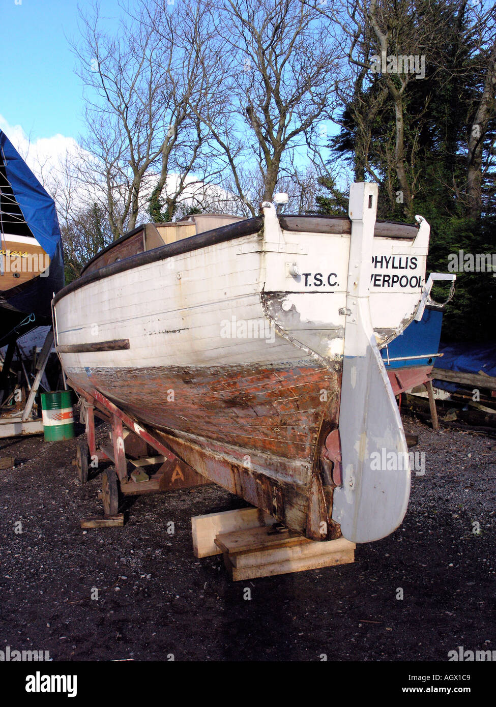 Wooden boat in boatyard for repainting Stock Photo