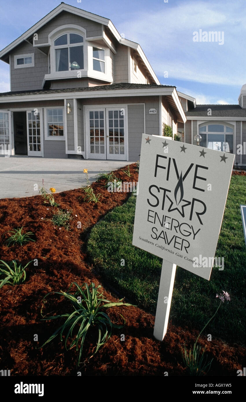 a sign in front of a model home for energy saving stock photo