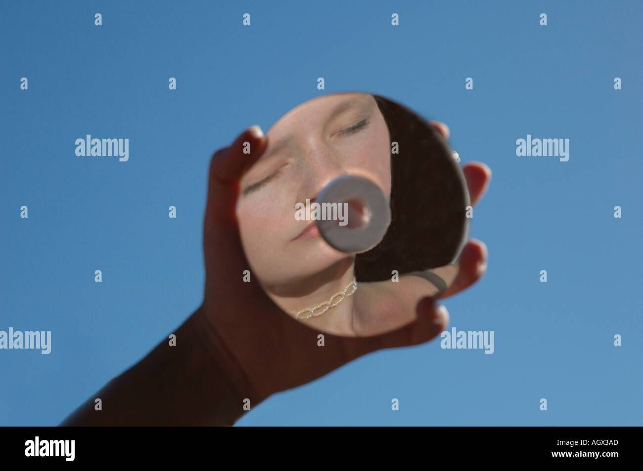 MR cd reflects woman s face - Stock Image