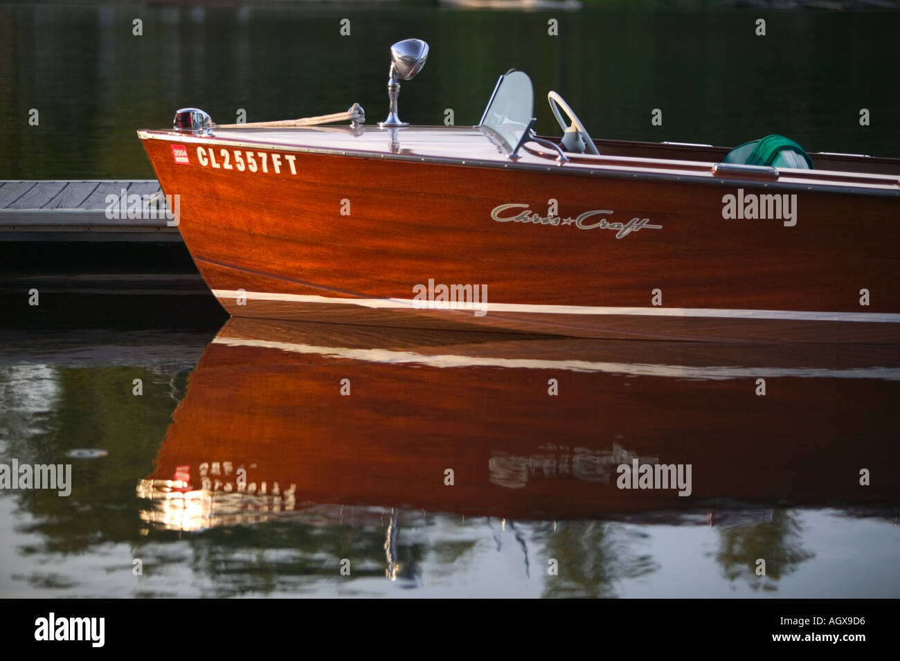 Chris Craft in late afternoon sun Sandpoint Wooden Boat Festival Bonner County Lake Pend Oreille Idaho USA - Stock Image