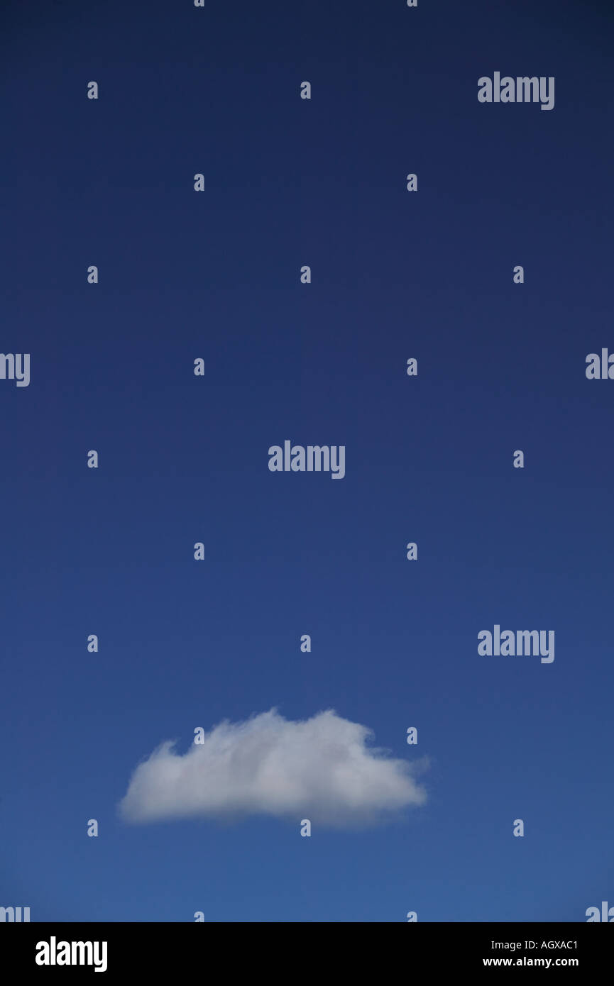 Single cumulus cloud in clear blue sky Sawtooth National Recreation Area Blaine County Idaho USA - Stock Image