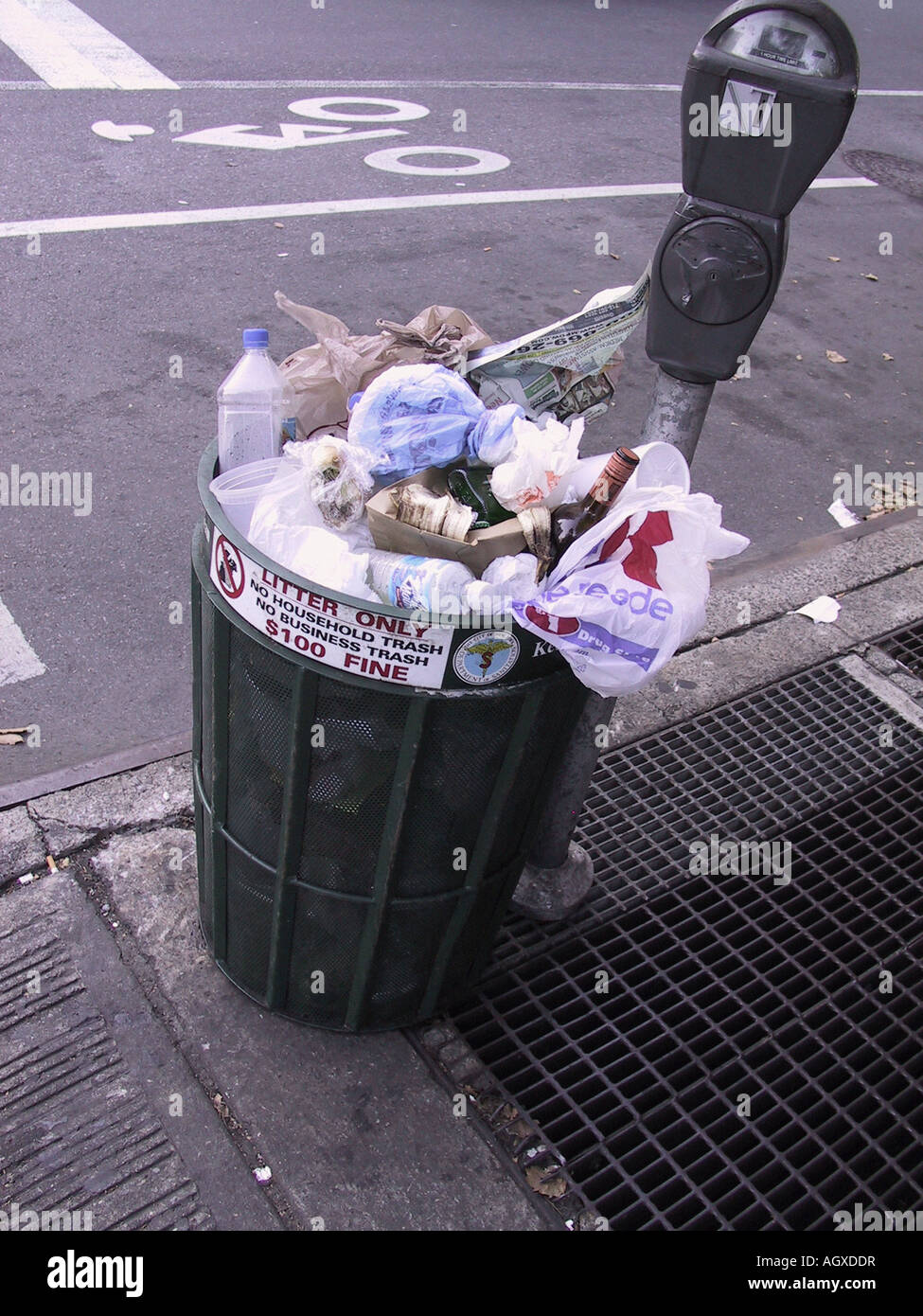 Trash can full, overflowing on the sidewalk in New York City