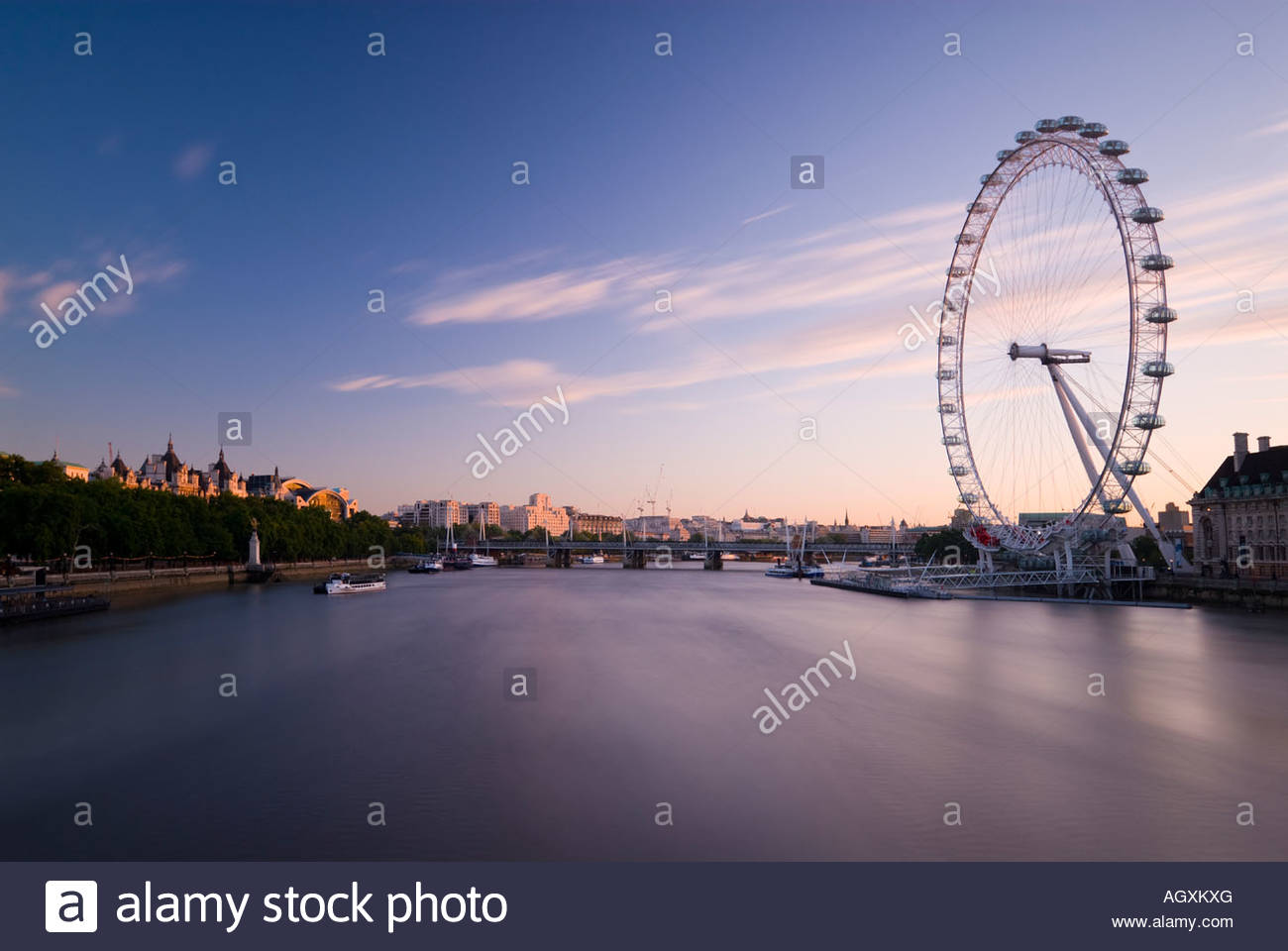 The London Eye and the river Thames at sunrise, London, England. Stock Photo