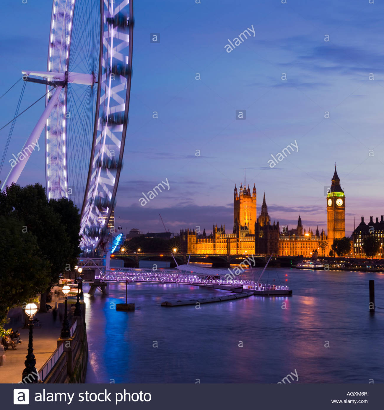 The London Eye and the Houses of Parliament at night, London, England. Stock Photo
