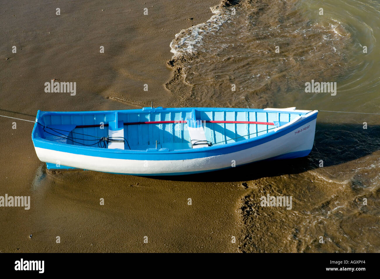 Blue and white rowing boat at mooring in harbour Puerto Viejo de Algorta Basque Country Spain - Stock Image