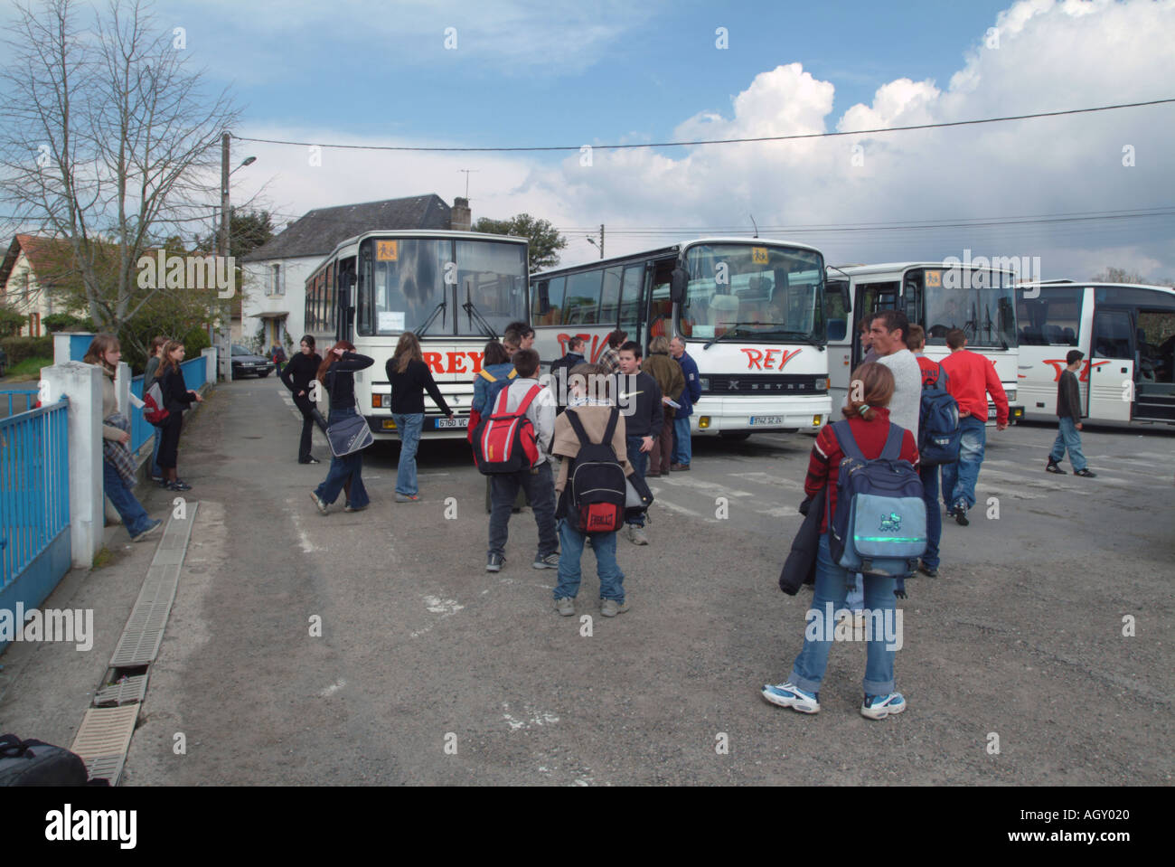 French school buses waiting at Leroi school le Bugue to take pupils to villages at the end of the day - Stock Image