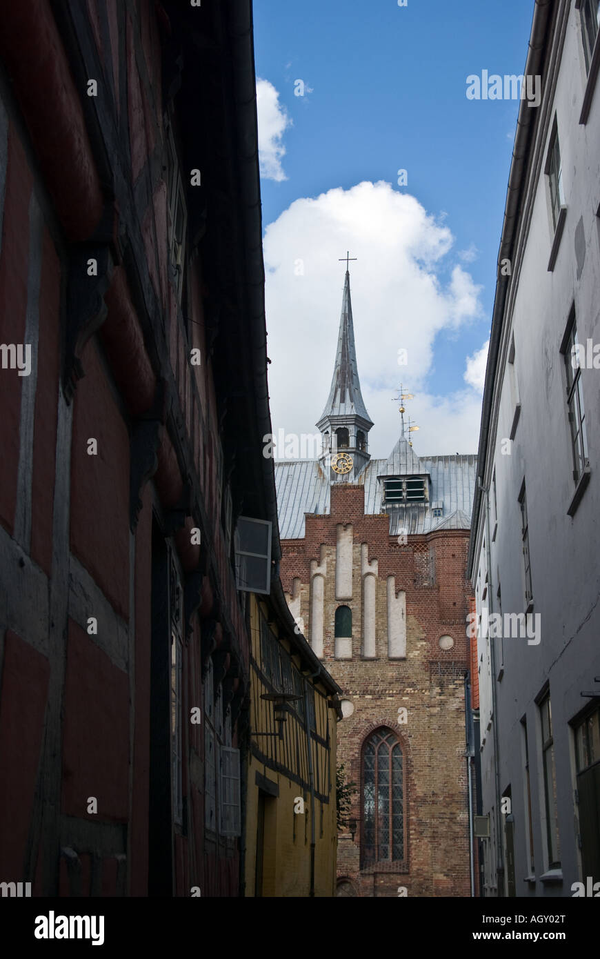 The cathedral in Haderslev, Denmark as seen through a narrow sidestreet. - Stock Image