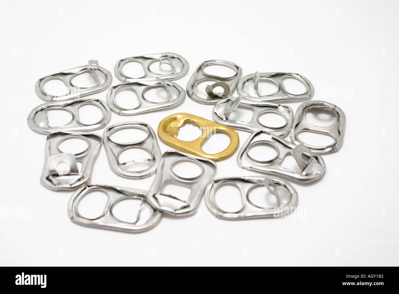 pull ring tabs from soft drink can with a single golden tab in the middle Concept stand out different - Stock Image