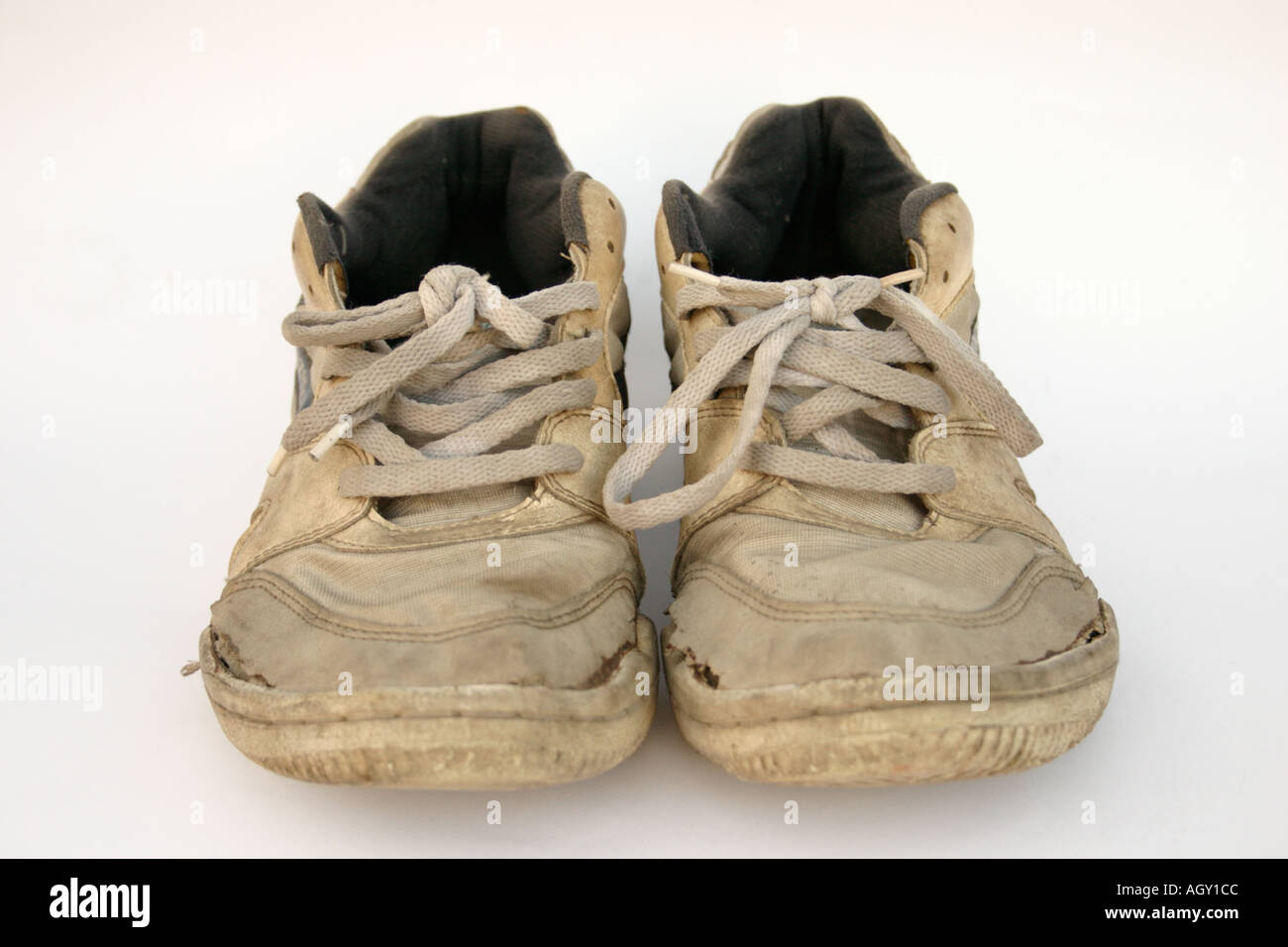 pair of dirty old worn sneakers comfort durability - Stock Image