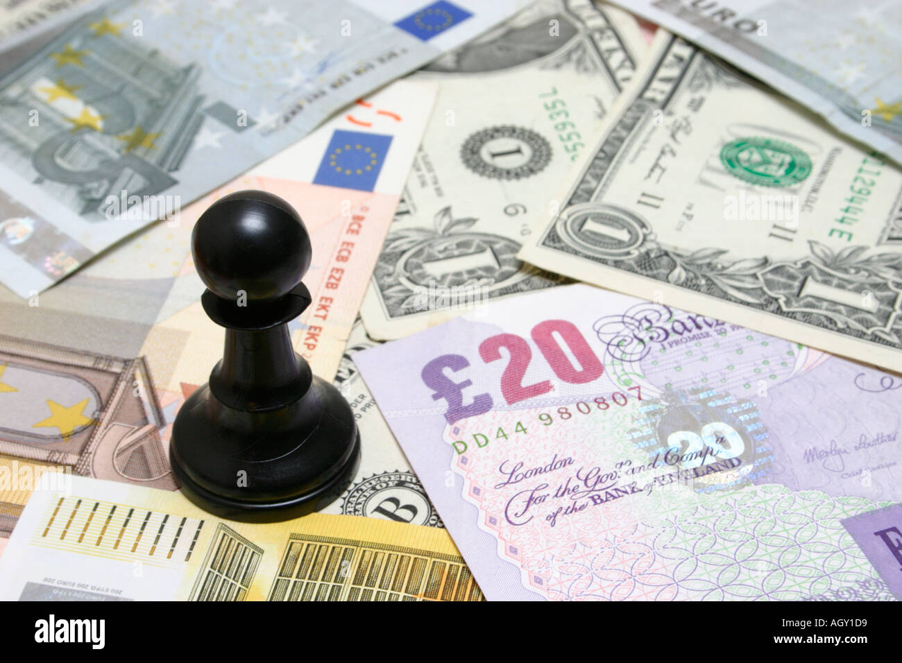 pawn sitting on cash ambitious pawn - Stock Image