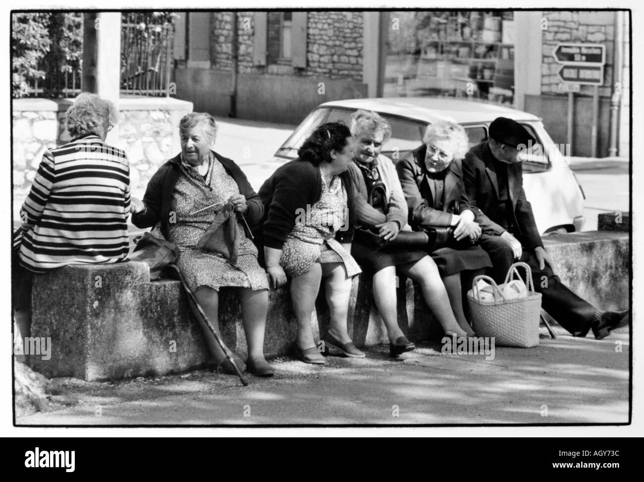 Image of: Face Street Photography Old People Sitting On Wall At The Street Stock Image Alamy Old People Chatting Street Black And White Stock Photos Images Alamy