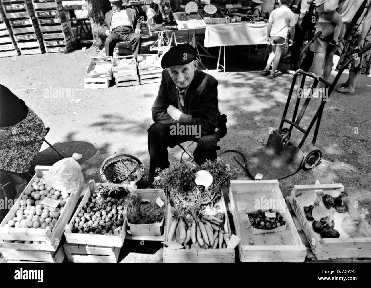 street photography man selling vegetable at a market in southern France - Stock Image