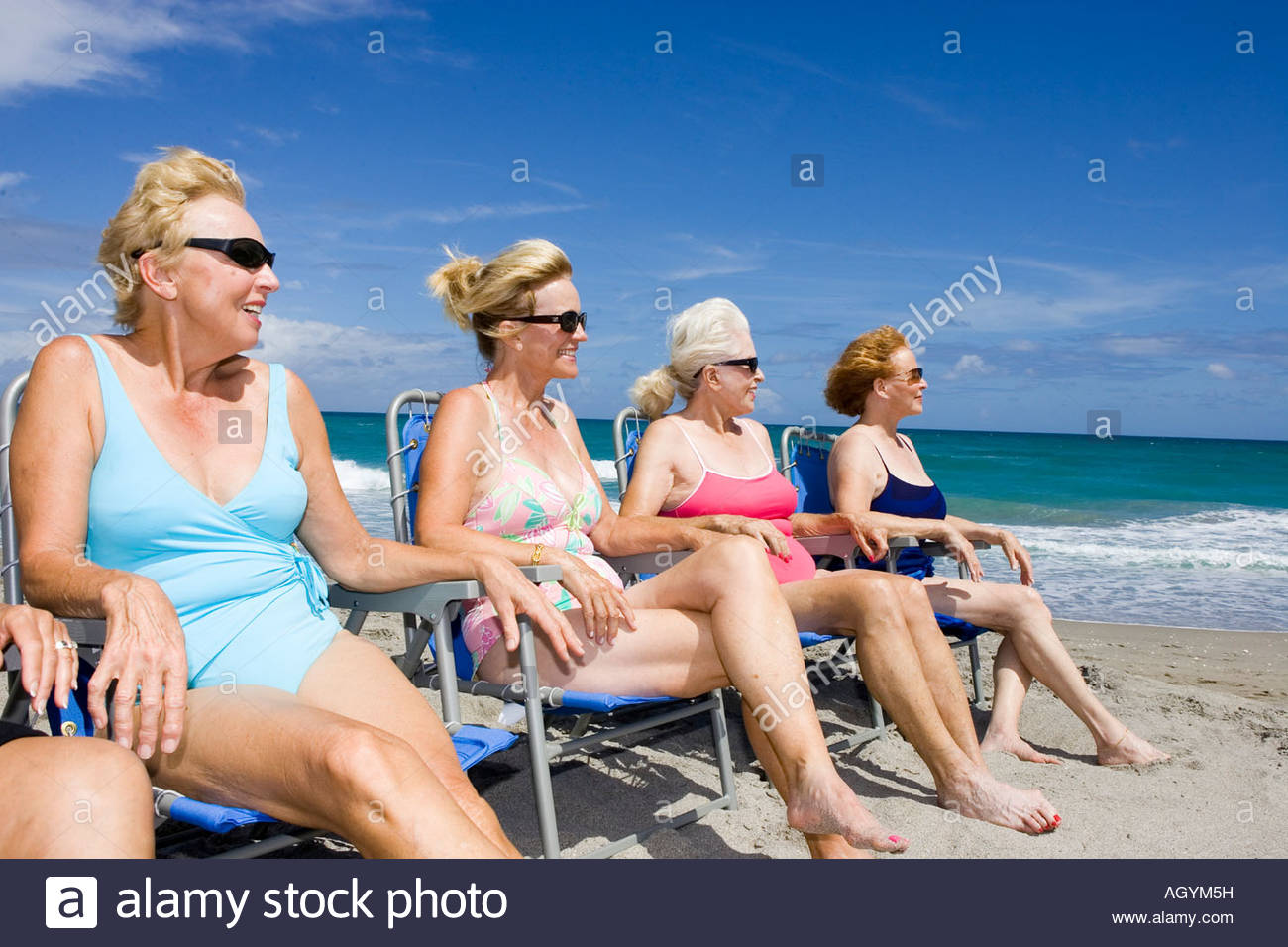 group of senior women in beach chairs stock photo: 14310076 - alamy