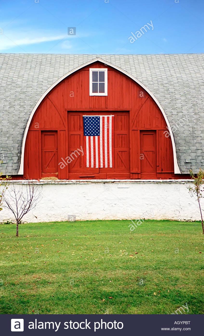 American flag hanging from barn door, Kewaunee County, Wisconsin - Stock Image