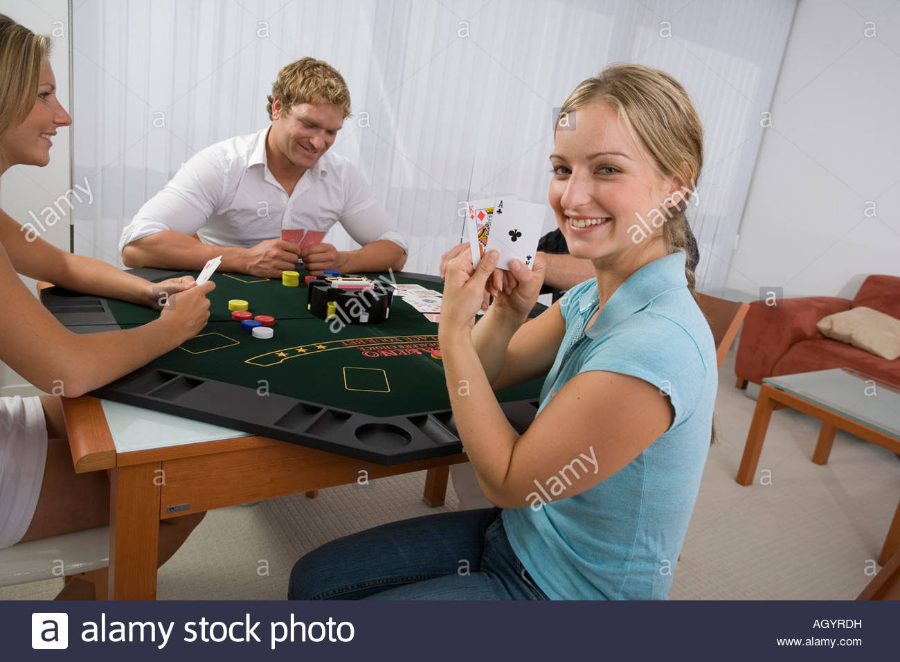 Woman revealing blackjack hand - Stock Image