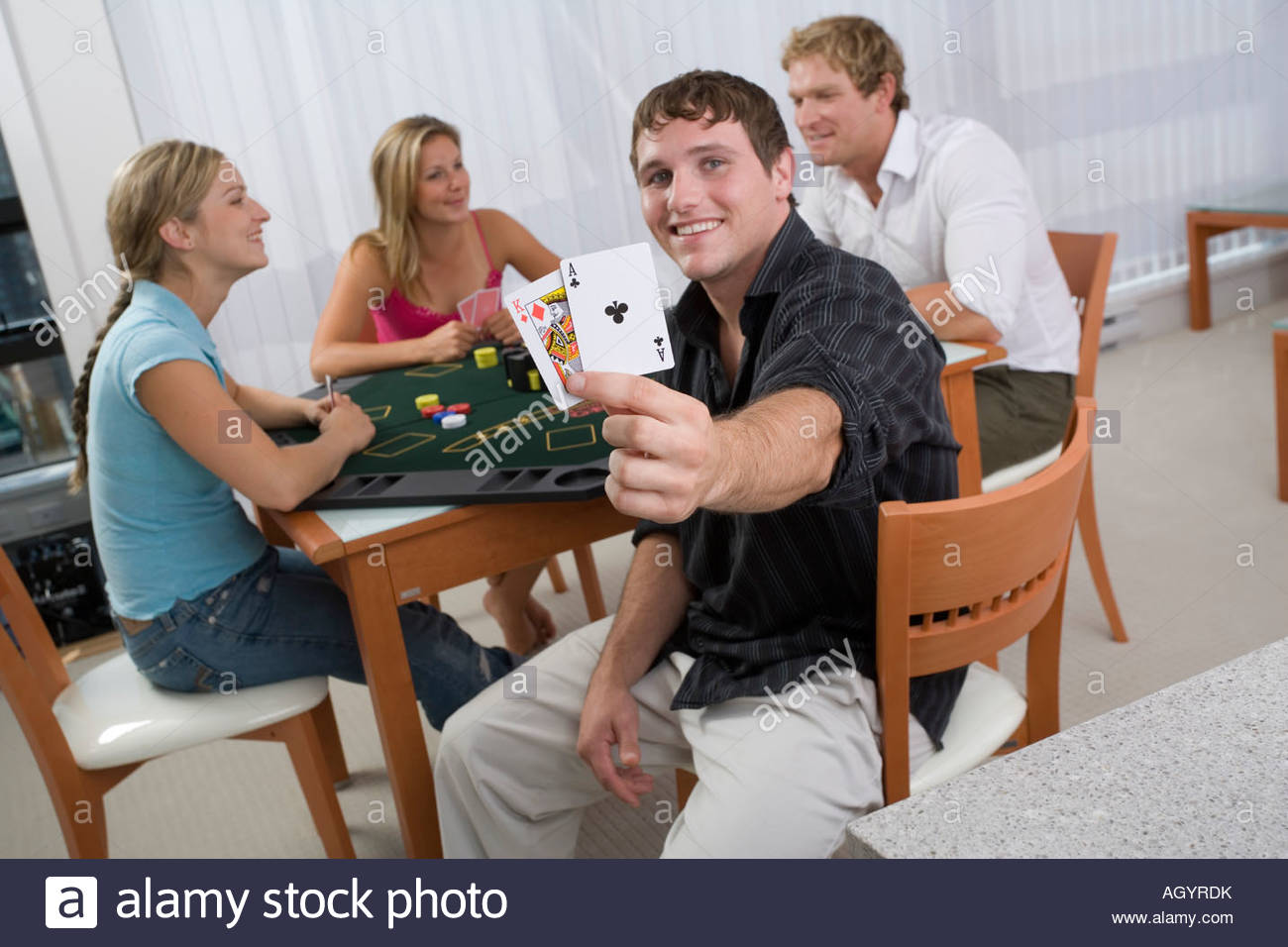 Man revealing blackjack hand - Stock Image