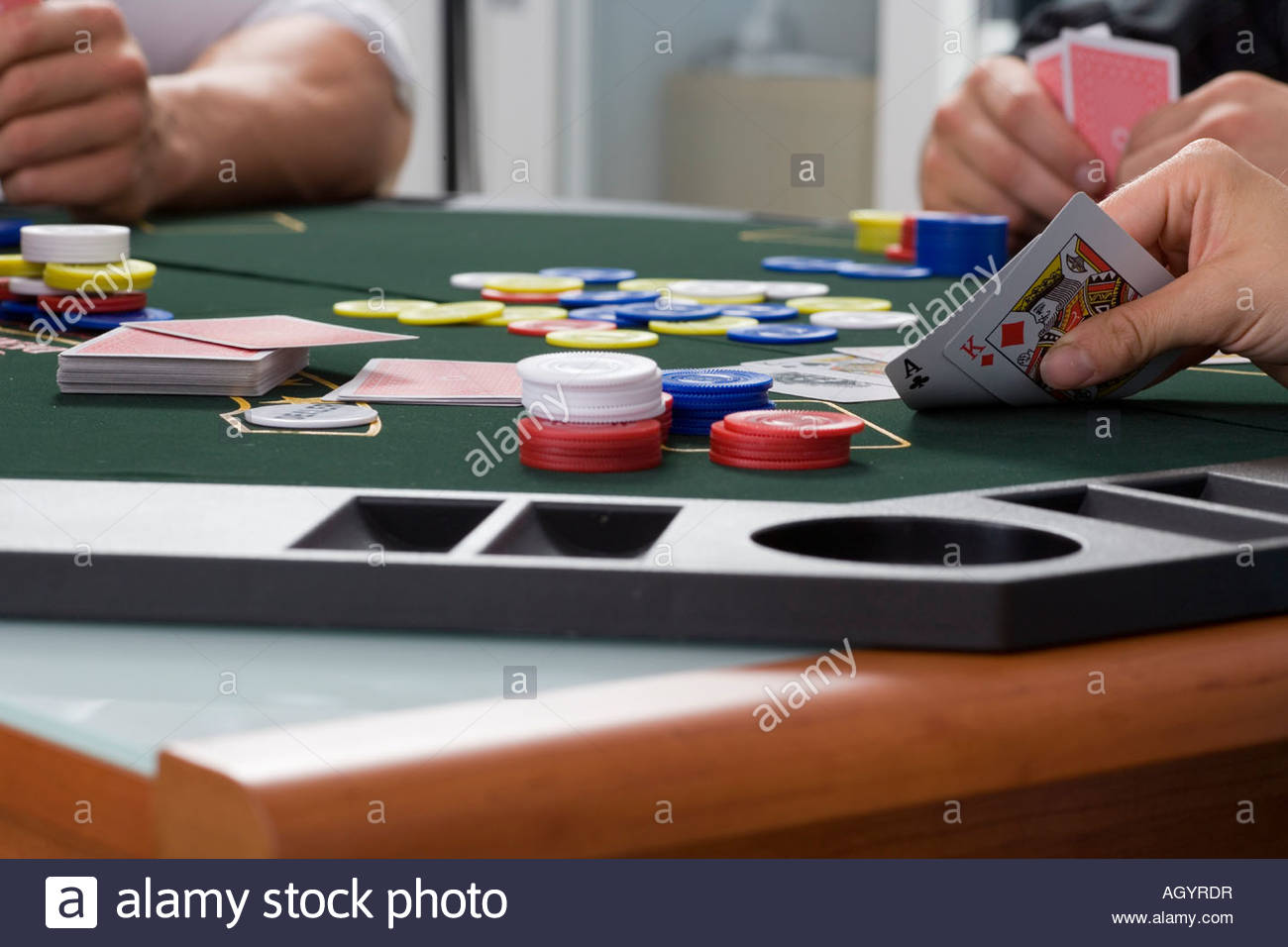 Close up of playing cards on poker table - Stock Image
