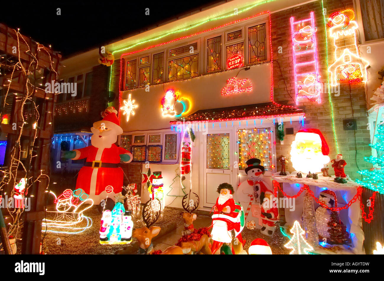 row of council houses with illuminated christmas decorations stock image