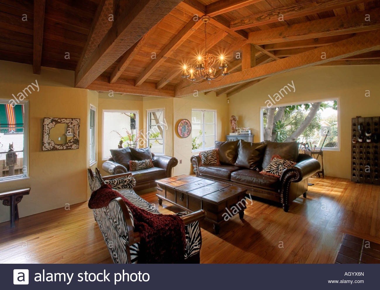 Cozy Rustic Living Room With Vaulted Wood Ceiling Stock