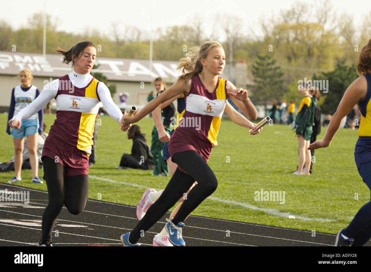TRACK Glenview Illinois Baton handoff for female relay team high school girls track meet - Stock Image