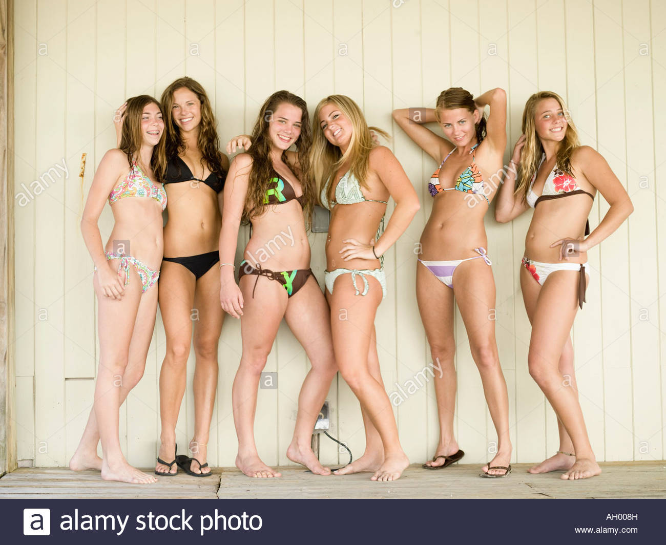 Teenage girls wearing bikinis