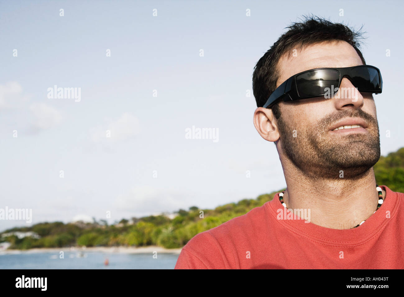 5665d2cadc78 Close-up of a mid adult man wearing sunglasses Stock Photo: 14314091 ...