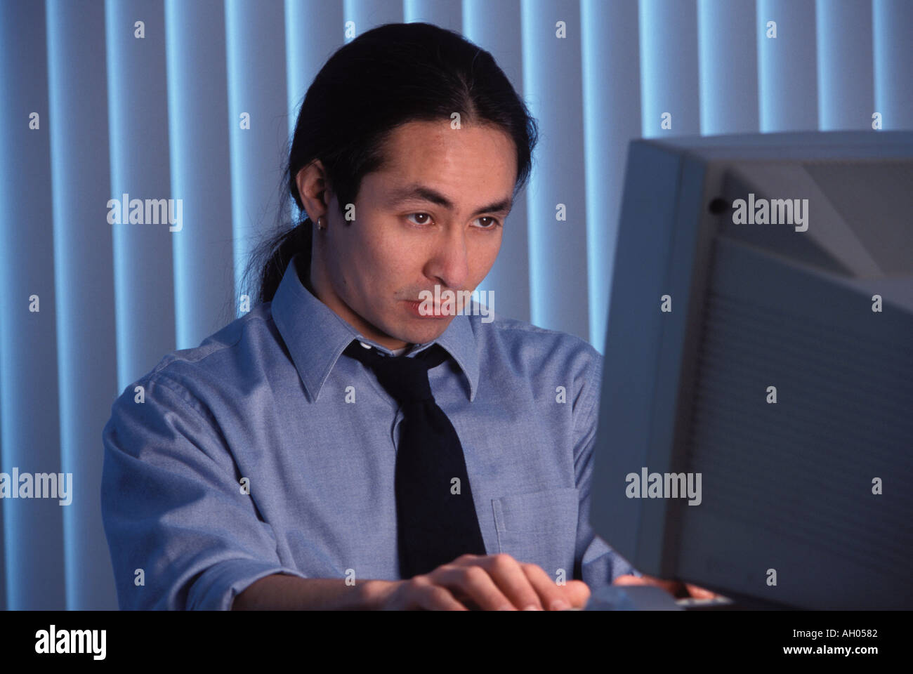 Man Working Late At Office - Stock Image